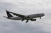An Air China Airbus A330-200 in Star Alliance livery, landing at Vancouver International Airport