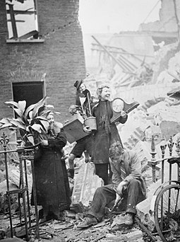 Women salvaging possessions from their bombed house, including plants and a clock Air Raid Damage in London, 1940 HU36206.jpg