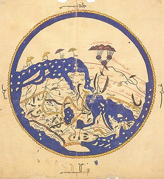 "Dhul-Qarnayn - Al-Idrisi's map (South up) shows ""Yajooj"" and ""Majooj"" (Gog and Magog) enclosed within dark mountains in the bottom-left edge of the Eurasian landmass."