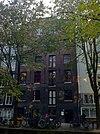 foto van Pakhuis met vijf verdiepingen onder zadeldak