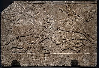 Assyrian relief depicting battle with camel riders, from Kalhu (Nimrud) Central Palace, Tiglath Pileser III, 728 BCE, British Museum Assyrian Relief depicting Battle with Camel Rider from Kalhu (Nimrud) Central Palace Tiglath pileser III 728 BCE British Museum AG.jpg
