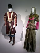 Azerbaijan national costume from Ganja in Heydar Aliyev Center.jpg