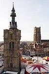 Béthune belfry and church during spring fair.JPG