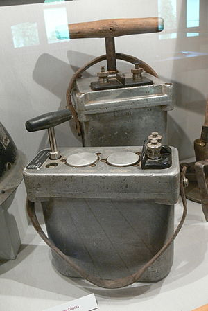 Blasting machine - Two blasting machines. At rear is one where the trigger works by depressing or raising the handle; at fore, one where the handle is twisted