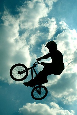 The silhouette of a BMX bicycle rider. From th...