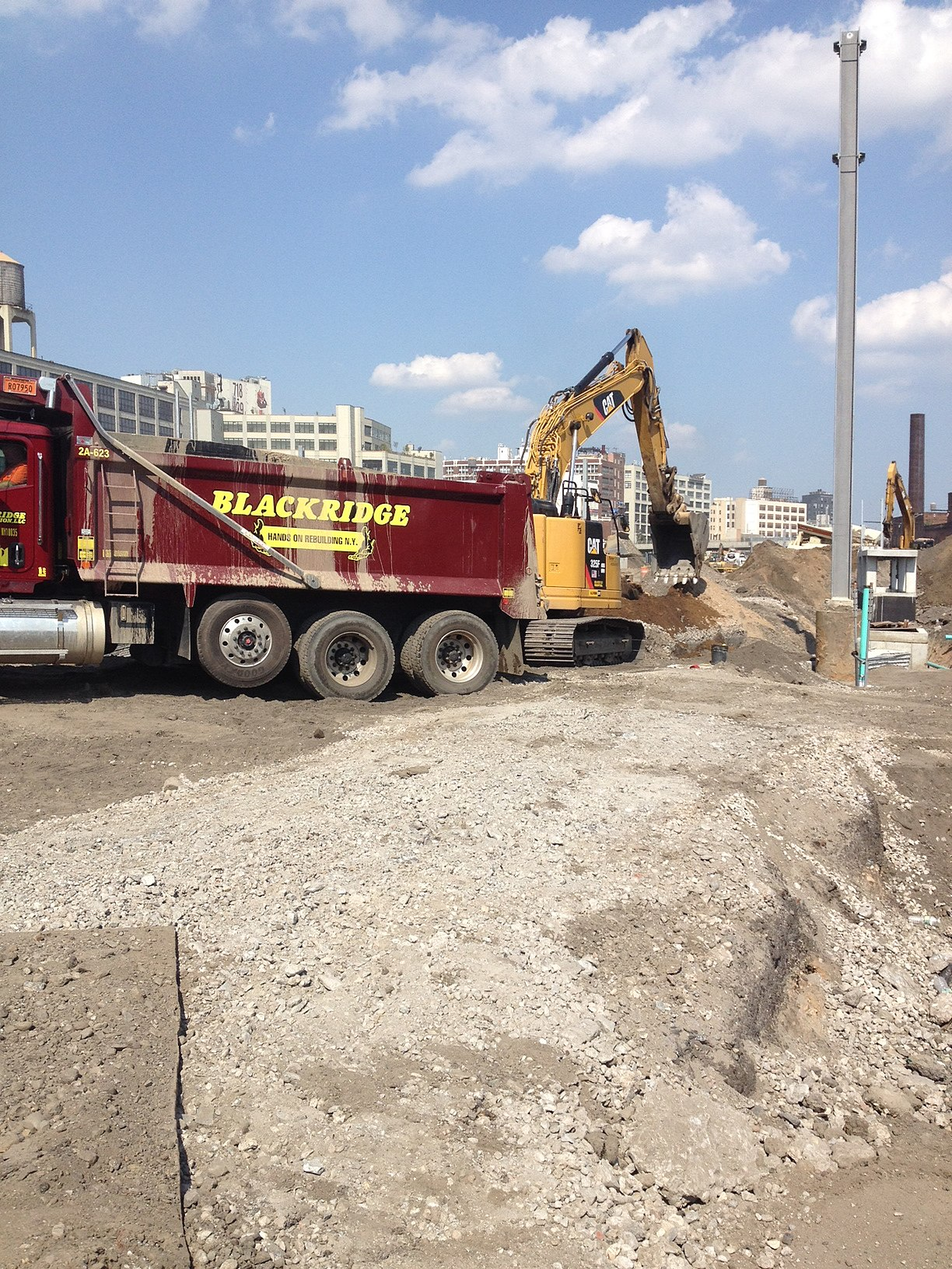 File:Backfilling a sewer line for the future Mid-day storage yard