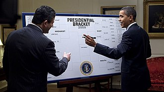 """Andy Katz - President Obama fills out his picks for the NCAA Men's Div I Tournament with ESPN's Andy Katz. President Barack Obama picked North Carolina to win the National Championship when he shared his """"Barack-etology"""" with Katz on March 18, 2009. Other teams in his Final Four were Pittsburgh, Louisville, and Memphis."""