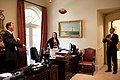 Barack Obama playing football in secretary's office.jpg