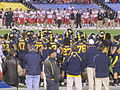 Bears in huddle at 2009 Poinsettia Bowl 1.JPG