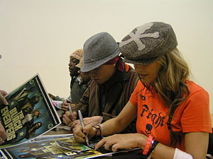 Taboo (rapper) - The Black Eyed Peas signing autographs before a concert at East Stroudsburg University of Pennsylvania in 2004.