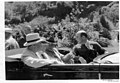 Black and white photograph of Hot Springs National Park Superintendent Thomas Allen in jump seat of open convertible limousine (e283fa83-6fa3-4dd2-92d7-a227e8500360).jpg