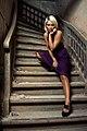 Blond woman on a Purple dress on stairs 02.jpg