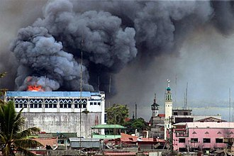 Battle of Marawi - A building in Marawi is set ablaze by airstrikes carried out by the Philippine Air Force
