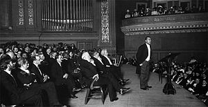 Tuskegee Institute Silver Anniversary Lecture - Booker T. Washington at Carnegie Hall in 1906.  Mark Twain is seated behind him.