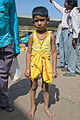 Boy on street near City Market, Bangalore in May 2008.jpg