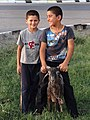 Boys with Goat - Street Scene in Bukhara - Uzbekistan (7502979804) (2).jpg