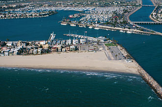 Breakwater (structure) - The Alamitos Bay, California entrance channel. Breakwaters create safer harbours, but can also trap sediment moving along the coast.
