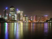 Brisbane by night from the southern bank of the Brisbane River, looking from east to west.