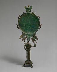 Bronze mirror with a support in the form of a draped woman