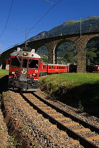 Rhaetian Railway ABe 4/4 III - ABe 4/4 III 55 and another ABe 4/4 III pass with their train underneath the spiral viaduct at Brusio.