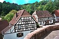 Bundenthal, half-timbered houses nearby the church.jpg