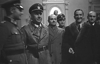 Round up of Marseille - French police head René Bousquet, in fur-trimmed coat, posing with Nazi German officials