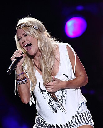 Carrie Underwood - Underwood performing at the 2013 CMA Music Festival