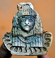 Carved ivory plaque of an Egyptian-looking woman. Nimrud Ivory. Sulaymaniyah Museum.jpg