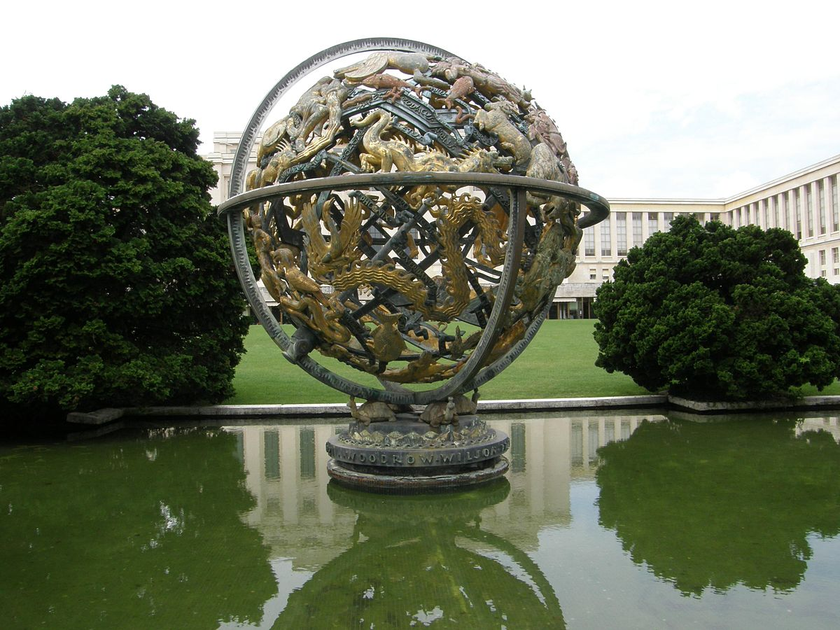 A large celestial sphere as a sculpture in a pond