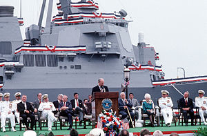 John Warner - Warner and fellow Virginia Senator Chuck Robb at the commissioning ceremony for the USS Arleigh Burke with Arleigh Burke and wife present and Secretary of Defense Dick Cheney delivering the keynote address, July 4, 1991.