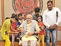 Children tying 'Rakhi' on the Prime Minister, Shri Narendra Modi's wrist, on the occasion of 'Raksha Bandhan', in New Delhi on August 29, 2015 (3).jpg