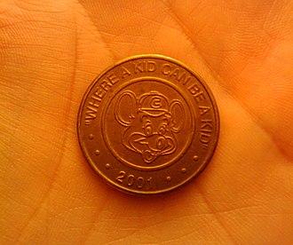 Chuck E. Cheese's - A 2001 Chuck E. Cheese token.