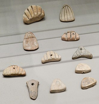 Uruk period - Accounting tokens from Susa, Louvre.