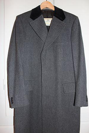 Covert coat - Grey covert coat with black velvet collar. Made by Aquascutum.