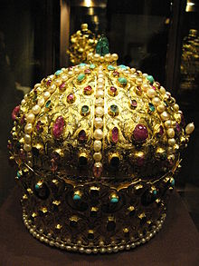 A golden crown decorated with gemstones