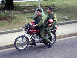Cuban Revolutionary Armed Forces - Soldiers of Fuerzas Armadas Revolucionarias on a motorbike