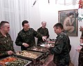 DD-SD-00-00201 COL Pazderski (German Army) stationed at the German Residency, in Sarajevo, helps serve Christmas dinner to US Army soldier..jpeg