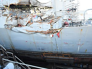 USS Fitzgerald and MV ACX Crystal collision - A detailed view of the damage to Fitzgerald. A patch has been welded over the below waterline damage. Image taken while in dry dock on 11 July 2017
