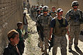 Defense.gov News Photo 100511-A-6225G-122 - U.S. Army soldiers from the 1st Platoon 401st Military Police Company an Afghan police mentor and members of the Afghan National Police walk.jpg