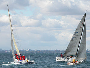 Canada's Cup - Defiant and Heartbreaker cross tacks in the 2003 Canada's Cup match, closely followed by umpire boats.
