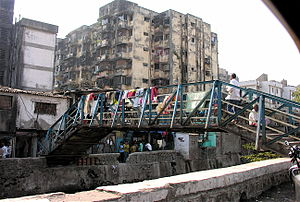 An entrance to the largest slum in Mumbai, and...