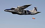 Dornier Do-228 of the Indian Coast Guard dropping a life raft.jpg