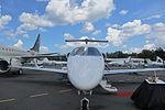Embraer Phenom 300 exterior nose.jpg