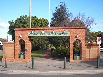 Enfield, New South Wales - The Coronation Parade arch displays 4 light bulbs which were originally the holders for the four electricity cables that ran along the former tram line
