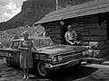 Ernest and Stella Gisseman of Midvale, Utah, pose next to their vehicle at the park entrance station. The Gissemans are the (653338f5f198473aabfd20ebf8ad38da).jpg