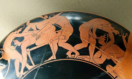 Erotic scene on the rim of an Attic red-figure kylix, c. 510 BC.