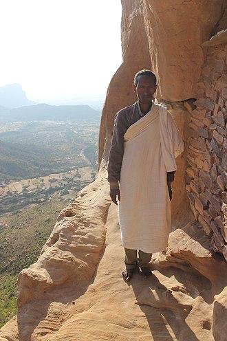 Hawzen (woreda) - Monk standing in front of Abuna Yemata Guh's entrance