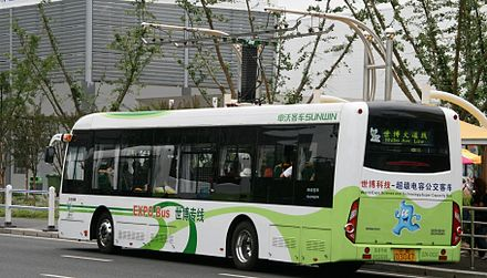 One of a fleet of electric capabuses powered by supercapacitors, at a quick-charge station-bus stop, in service during Expo 2010 Shanghai China. Charging rails can be seen suspended over the bus. Expo 2010 Electric Bus.jpg
