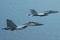 FA-18E Super Hornet of VFA-81 in flight with Malaysian Su-30MKM in May 2015.JPG