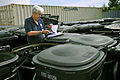 FEMA - 44374 - FEMA PA officer documenting municipal refuse comntainer damages in OK.jpg
